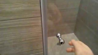 видео Душевые стеклянные двери в нишу