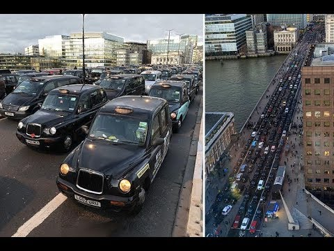 More than 200 black cabs bring London Bridge to a standstill in protest against Uber