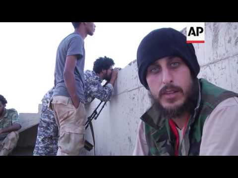 Libyan National Army troops battle militants