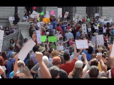 Teachers join protest against US Secretary DeVos' meeting in Denver