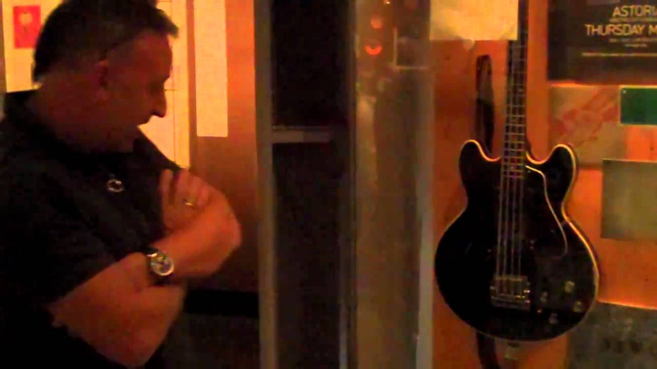 Joy Division/New Order co-founder Peter Hook checks out his Rock Hall exhibit for the first time.