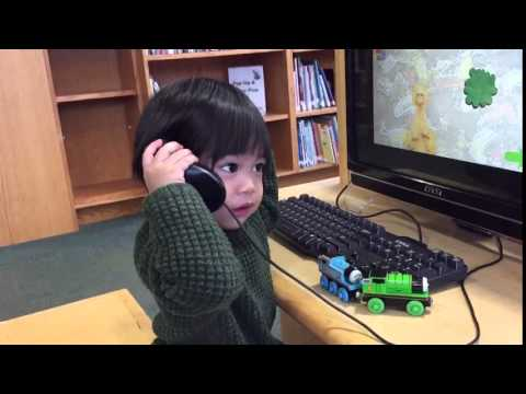 Toddler playing Thomas the train interrupted by a phone call