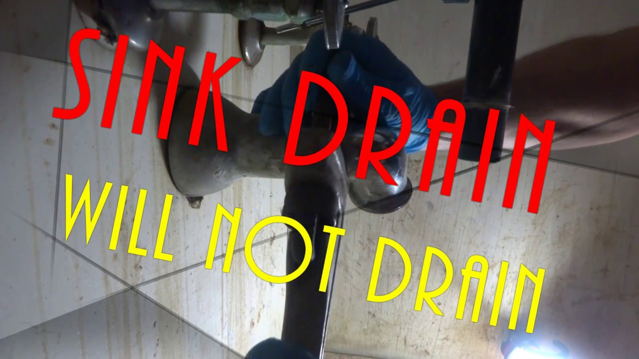sink slow drain water will not go down, plumbing ,clogged ...