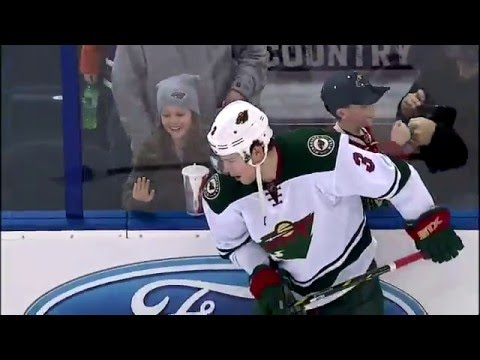 Charlie Coyle flips pucks to kids