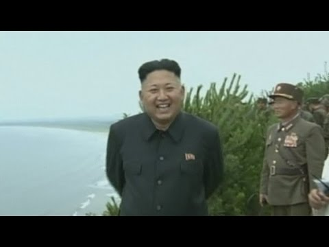 North Korea: Kim Jong Un smiling as he watches military exercises