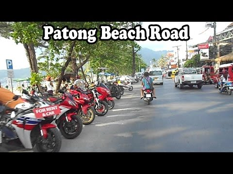 Patong Beach Road, Phuket Thailand on a motor scooter.