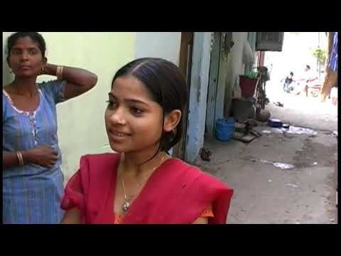 English man conversation with a  girl in India who lives in slum