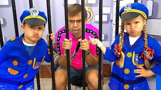 Diana and Roma play different professions at the Children's Museum