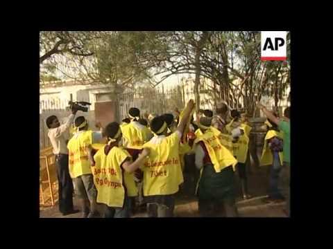 WRAP Pelosi meets Dalai Lama; protesters scale wall of Chn embassy