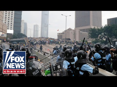 Demonstrators surround government buildings in Hong Kong, protest against extradition bill