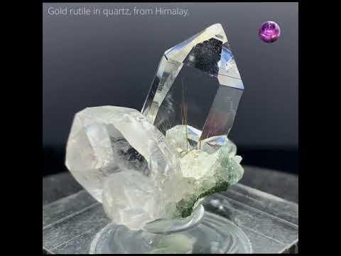Rutile in clean quartz cluster.