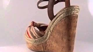 Espadrille and cork combo platform wedge in multi color print knotted straps. Adjustable ankle strap