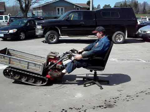 Man Uses motorized Wheelbarrow  Office Chair for a