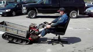 Man Uses Motorized Wheelbarrow & Office Chair For A Spinning Ride!!! Watch Him Crash!!