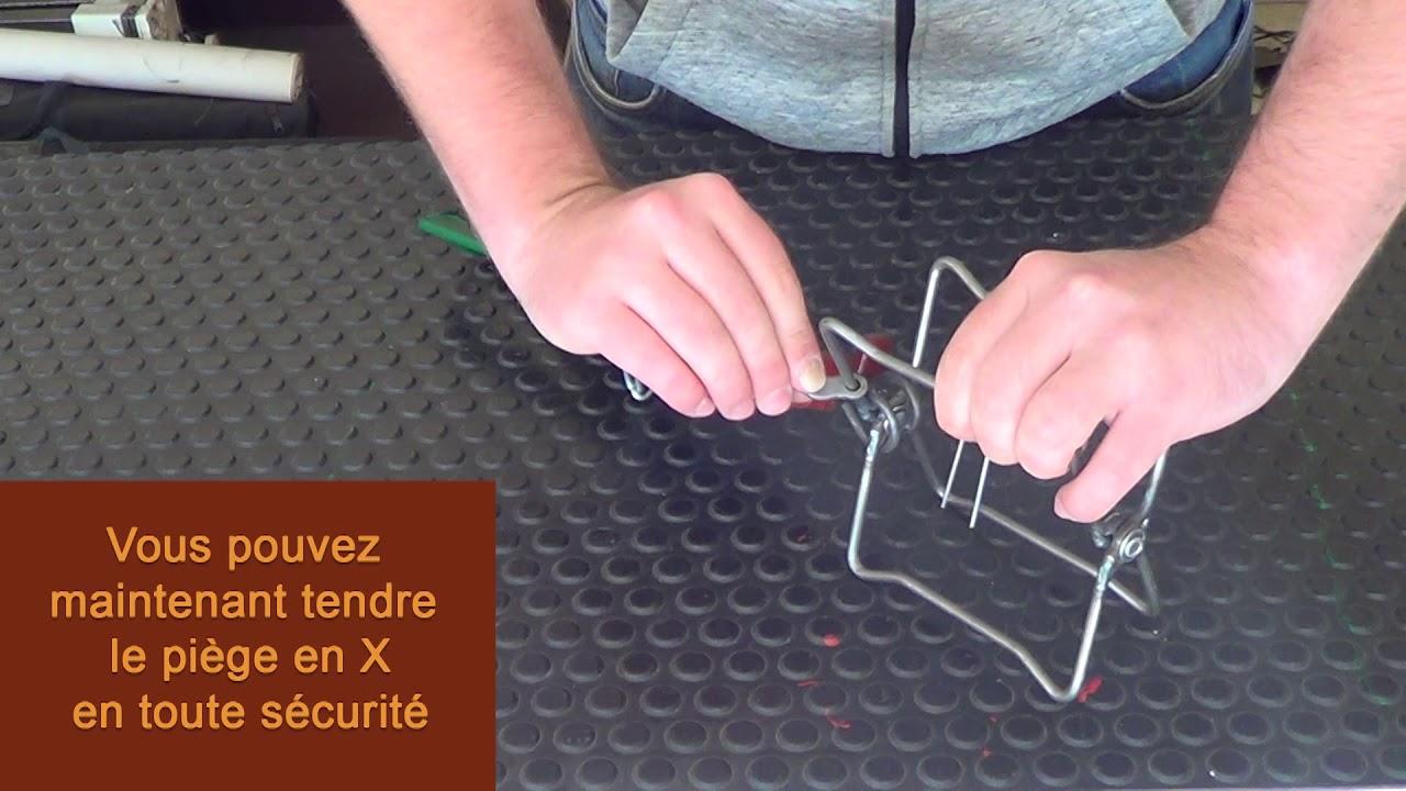 utilisation de la cle pour tendre un piege en x de 13x13cm