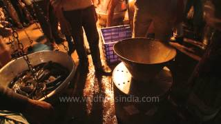 Fish being weighed for market sale in West Bengal