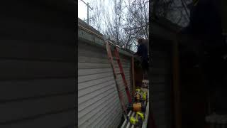 Back side of fachiya and soffet being installed on Garage brought t...