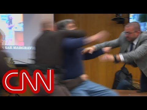 Father lunges at Larry Nassar in court