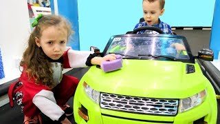 Ulyana pretend plays car wash worker and helps daddy