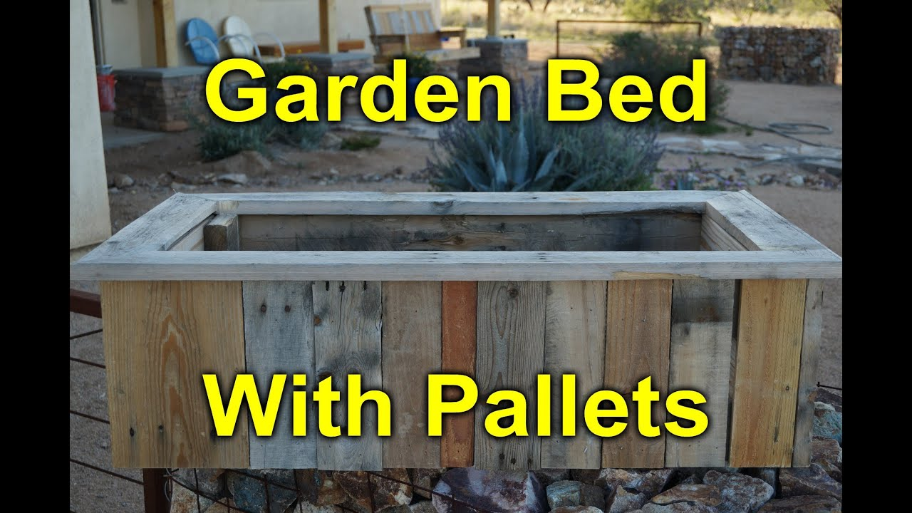 Rustic garden bed built with pallet wood youtube for How to make garden beds from pallets