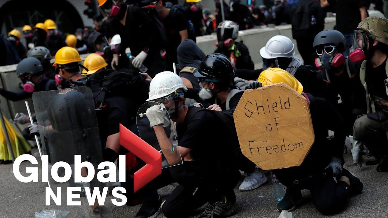 Hong Kong protests: Demonstrators barricade roads, throw bricks at police in Kwun Tong