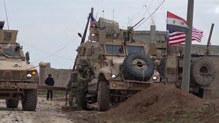 Американские военные в Сирии открыли огонь по мирным жителям.
