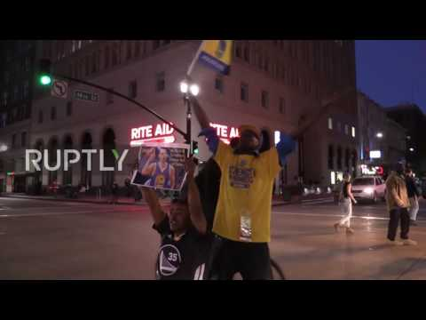 USA: Golden State Warriors fans celebrate NBA title victory in downtown Oakland