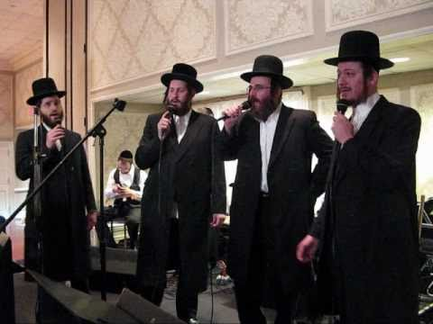 Isaac Honig sings at a Chupah