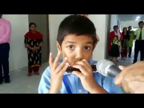 Rudraneel Matilal (Class 2) playing Harmonica at Mount Litera Zee School DHR Assembly