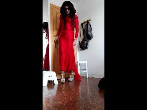 Crossdresser Francis Espada with wonderful red satin dress and silver heels