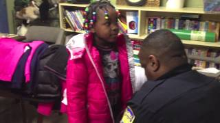 Rock Hill police officers donate coats for children