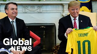 Trump, Bolsonaro exchange national soccer team jerseys U.S. President Donald Trump and Brazilian President Jair Bolsonaro exchanged their country's team soccer jerseys with each other's names printed on the back., From YouTubeVideos