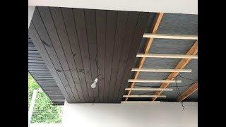 Обшивка потолка деревом, сосной под покраской на улице.