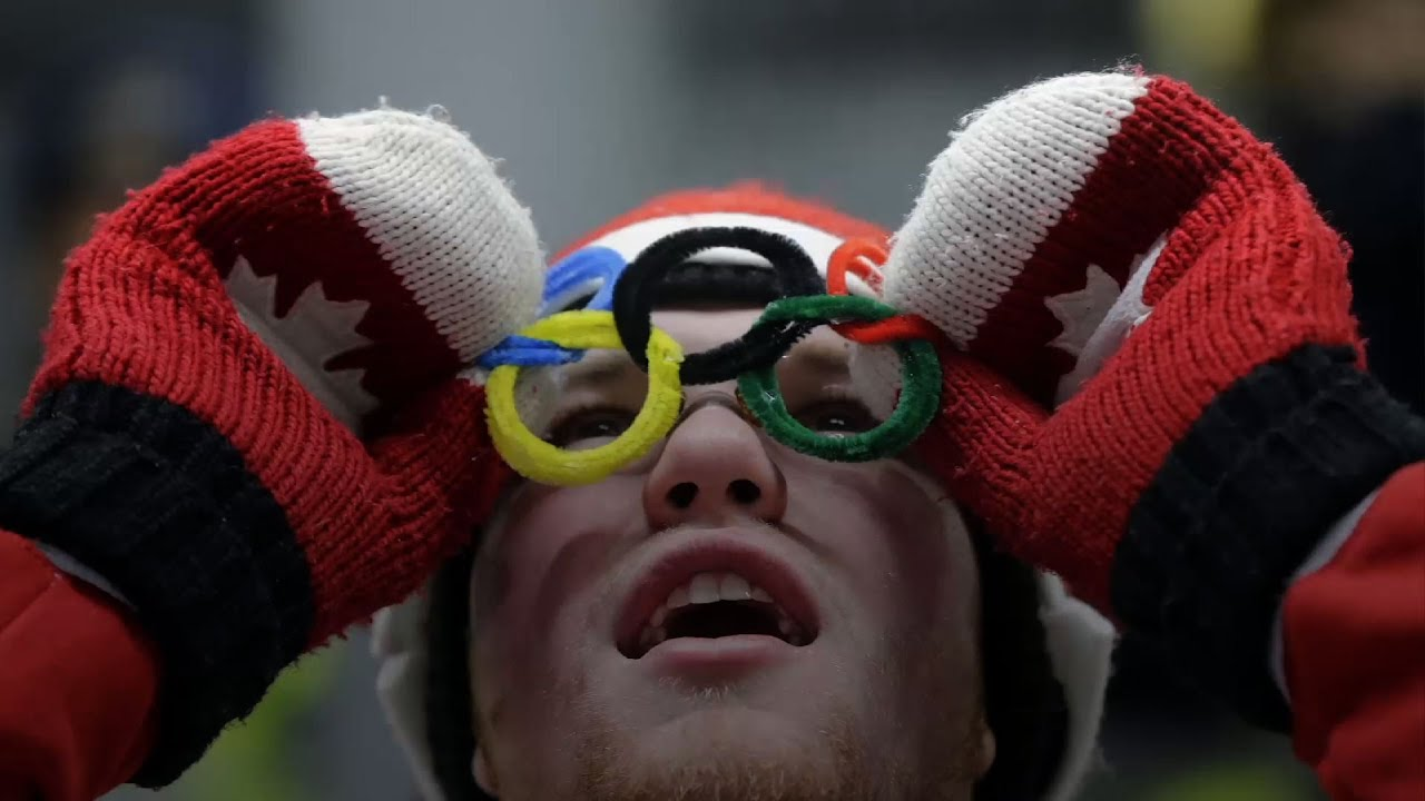 Olympic Fans Show Their National Spirit