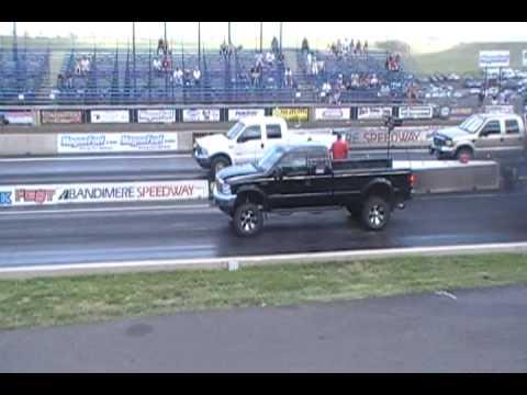 drag race lifted ford 6.0 powerstroke diesel vs stock ford 7.3 power stroke black smoke