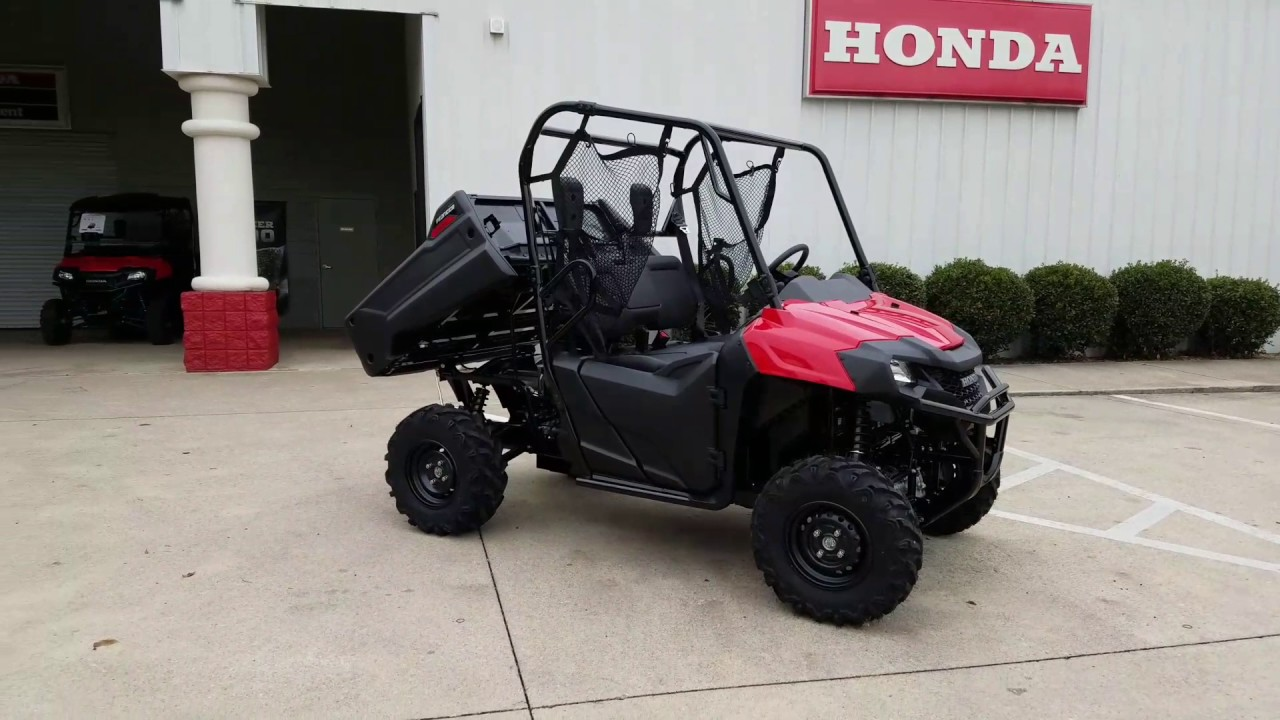 accelerating series through canada red standard honda on by pioneer riders side four wilderness atv