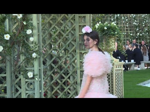 AFP news agency: Chanel goes girly with pretty-in-pink walk in the park