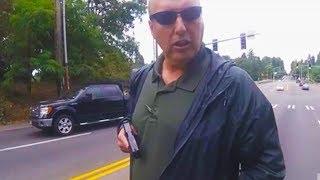 Cop Pulls Gun On Biker (VIDEO)