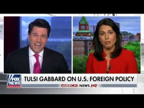 Flailing Fox Host Smears Tulsi To Her Face In Bizarre Segment