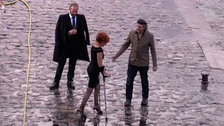 French Pop singer Mylene Farmer arriving on crutches on the set of her latest clip in Paris