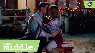 Sue and Sean Kiss- The Middle