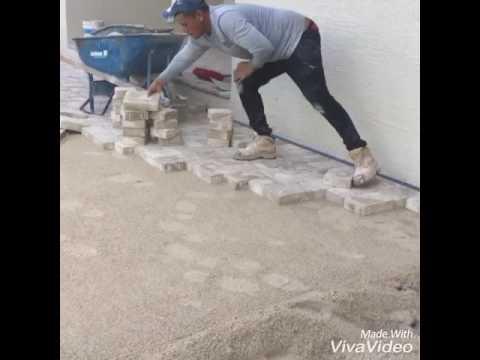 Pool deck pavers installation by DM Pavers LLC 239-440-2373
