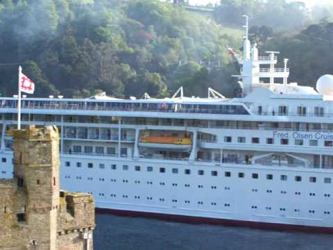 Braemar cruise vessel entering near Dartmouth Castle pulled by tug