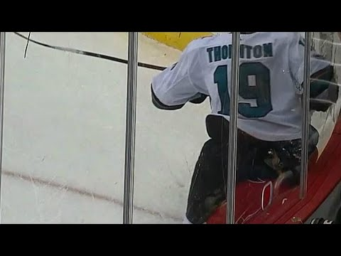 Oshie gets head smashed in by Thornton's behind, leaves game