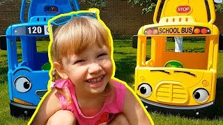 Alena and Pasha are playing with a little bus Tayo