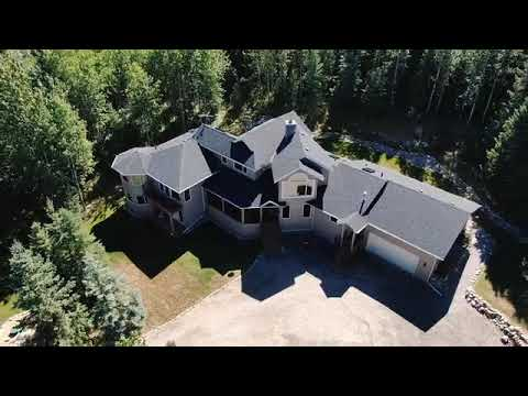 incredible-home-backing-onto-natural-area-in-bragg-creek-alberta-2-acres-in-a-lake-community