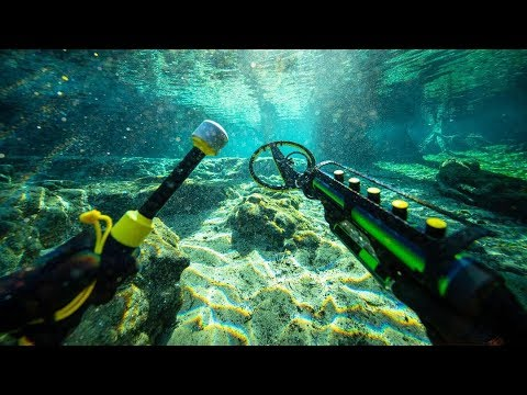 Metal Detecting Underwater for Buried Treasure While Scuba D
