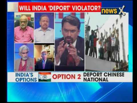 Insight: Chinese national tears up Indian flag, chaos erupts