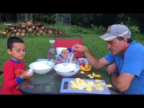 Cooking Southern Style Yellow Crookneck Squash Outside On A Wood Fire Grill In Summer