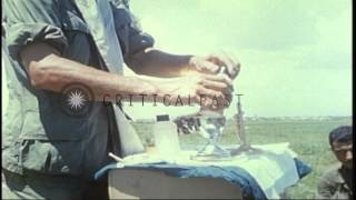US Army Chaplain Captain Angelo Liteky conducts Mass with Communion for soldiers ...HD Stock Footage